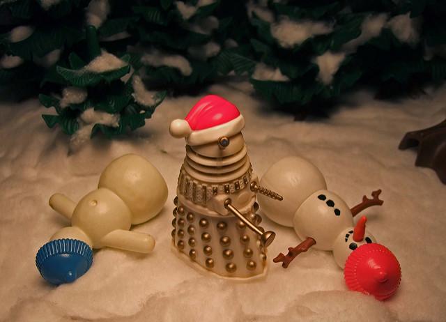 A photo of some Dalek toys with Santa hats