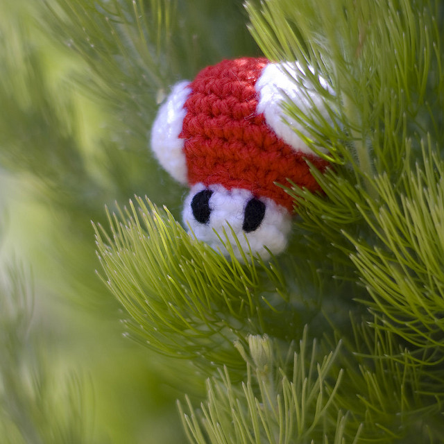 A photo of a handmade mushroom from Nintendo Mario games hanging on a Christmas tree