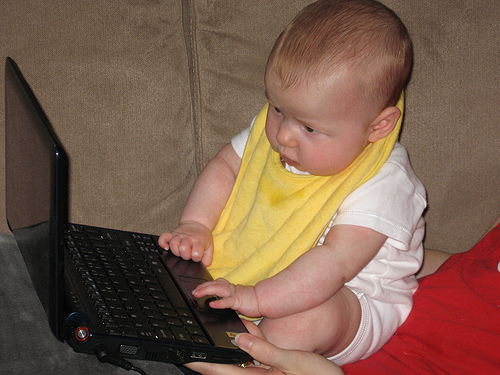 A baby using a laptop